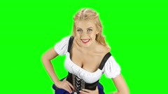 Girl in bavarian costume puts hands on hips. Green screen Stock Footage