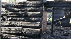 Burned wooden house Stock Footage