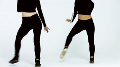 Dancing two girls on a white background in studio Stock Footage