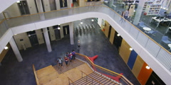High View of Students walking around a large modern university building Stock Footage