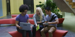 Diverse group of students in large modern university building Stock Footage