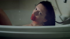 4k Thriller Shot of a Woman in Bath Room Having Blood on Mounth Stock Footage