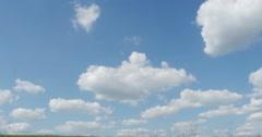 Single Hay Bale in Green Grass Farm Field Blue Sky Tilting Down, 4K Stock Footage