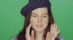 Young redhead woman wearing a beret smiling and making silly faces Stock Footage