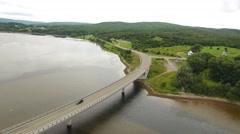 Aerial shot of a car travelling over a bridge in Cape Breton Nova Scotia Stock Footage