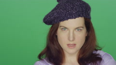 Redhead woman wearing a beret posing and making seductive faces Stock Footage