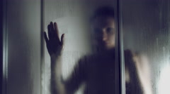 4k Thriller Shot of a Woman in Bath Room Wiping shower Window Stock Footage