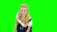Girl in a bavarian costume and offers someone for the glasses with beer. Green Stock Footage