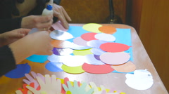 People do applique of colored balls with glue and colored paper Stock Footage