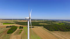 Panning Past a Moving Wind Turbine 4K Stock Footage