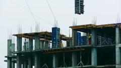 Hoist moves the plate in the construction of high-rise building, Timelapse Stock Footage