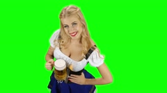 Bavarian girl in bavarian costume holding a glass of beer and laughs. Green Stock Footage