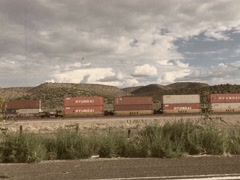8mm Vintage Style Freight Train in American Countryside Stock Video Stock Footage