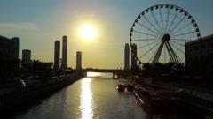 Al Qasba canal and ferris wheel in Sharjah city, United Arab Emirates Stock Footage