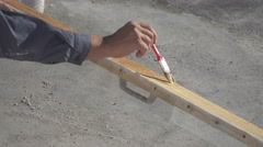 Painter varnishes wooden detail, close-up Stock Footage