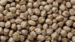 Rotating raw chickpea beans, vegan healthy nutrition Stock Footage