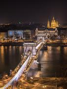 Chain Bridge and St. Stephen's Basilica in Budapest, Hungary at Night Stock Photos
