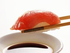 Chopsticks Holding Maguro Sushi Over Soy Sauce Stock Photos