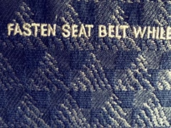8mm Vintage Style Fasten Seatbelt in Airplane Stock Video Stock Footage