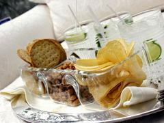 Assorted Munchies with Gin and Tonics on a Tray Stock Photos