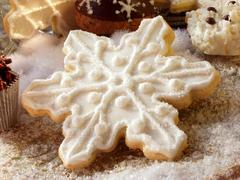 Sweet pastry biscuit shaped like a snowflake Stock Photos