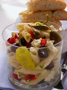 Greek pasta salad with olives & sheep's cheese Kuvituskuvat