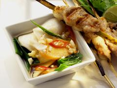 Pork and shrimp kebabs with Asian vegetable salad Stock Photos