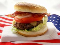 Hamburger with bacon on American flag Stock Photos