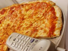 Call a pizza: Pizza margherita with telephone Stock Photos