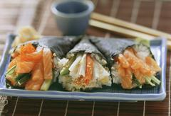 Temaki sushi with salmon and crabmeat Stock Photos