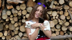 Beautiful girl holds in hands three little kittens Stock Footage