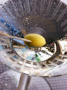 Martini with green olive on toothpick (view from above) Stock Photos