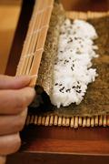 Preparing rolled sushi Stock Photos