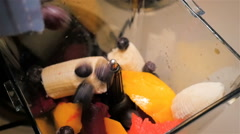 Pouring Fruits into Blender for Smoothie Stock Footage