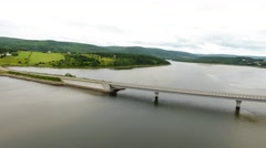 Aerial shot of car driving over bridge above river Stock Footage