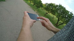 Man using navigation app on the mobile phone Stock Footage