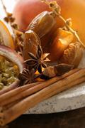 Still life with dates, star anise, cinnamon, granadilla & mango Stock Photos