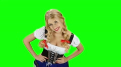 Girl in bavarian costume seductive beckoning by finger to herself. Green screen Stock Footage