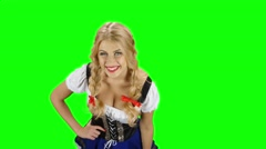 Girl in bavarian costume drinking beer from the glass and licked. Green screen Stock Footage
