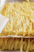 Ribbon pasta on paper Stock Photos