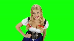 Girl in bavarian costume drinking beer and shows the thumb. Green screen Stock Footage