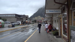 C0134-Tourists stroll South Franklin St Juneau AK rainy day Stock Footage