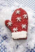 Chocolate praline glove for Christmas Stock Photos