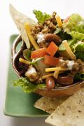Mexican salad with mince, vegetables and cheese Stock Photos