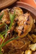 Braised chicken with onions in tajine Stock Photos
