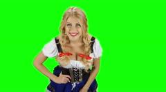 Girl in bavarian costume flirting with someone. Oktoberfest. Green screen Stock Footage