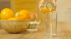 Orange juice pouring into glass Stock Footage