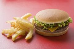 Cheeseburger with chips Stock Photos
