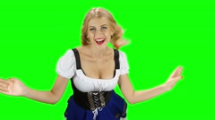 Woman in bavarian costume playing with her hair and laughs. Green screen Stock Footage