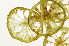 Deep-fried slices of candied lime, backlit Stock Photos